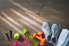 Fitness equipment, healthy food, sneakers, water bottle and towe Stock Photography