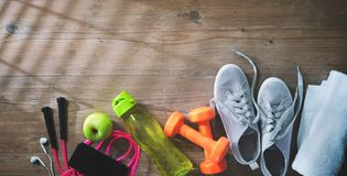 Fitness equipment, healthy food, sneakers, water bottle and towe Stock Image