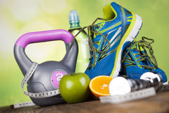 Fitness equipment and healthy food Stock Photography