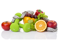 Fitness equipment and healthy food. On white Royalty Free Stock Photo