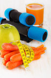 Fitness equipment and healthy fresh  food - health and diet conc Royalty Free Stock Images