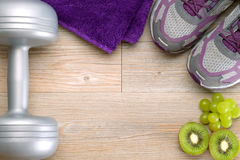 Fitness equipment and healthy fruits Royalty Free Stock Photo