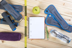 Fitness Equipment And Healthy Nutrition. Sport Equipment. Dumbbells,  Ankle Weights, Wrist Weights, Towel, Tape Measure, Bottle Of Water, Notebook To Workout Stock Images