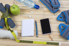 Fitness Equipment And Healthy Nutrition. Sport Equipment. Dumbbells,  Ankle Weights, Wrist Weights, Towel, Tape Measure, Bottle Of Water, Smart Phone With Stock Image