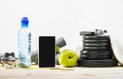 Fitness Equipment And Healthy Nutrition. Sport Equipment. Dumbbells, Free Weights, Barbell, Hand Grip, Towel, Tape Measure, Bottle Of Water, Smart Phone To Royalty Free Stock Photos