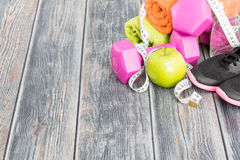 Fitness equipment and healthy nutrition. Royalty Free Stock Photography