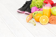 Fitness equipment and healthy nutrition. Fitness equipment and healthy nutrition on wood background Royalty Free Stock Photos