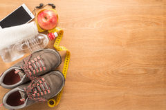 Fitness equipment and healthy nutrition. On  wooden background Royalty Free Stock Image