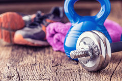 Fitness Equipment. Kettlebell  dumbbells towel water and measuring tape Royalty Free Stock Photography
