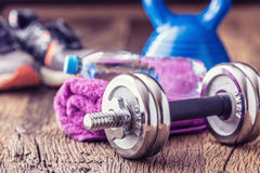 Fitness Equipment. Kettlebell  dumbbells towel water and measuring tape Stock Image