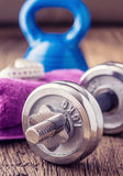 Fitness Equipment. Kettlebell  dumbbells towel water and measuring tape Royalty Free Stock Photos
