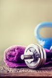 Fitness Equipment. Kettlebell  dumbbells towel water and measuring tape Royalty Free Stock Images