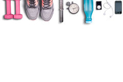 Fitness equipment on pure white background. Pink dumbbells and light shoes to running. Stock Images