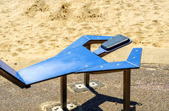 Fitness equipment at the sandy beach, blue ocean, public gym, se. Aside resort, active sport Stock Images