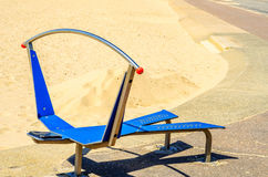 Fitness equipment at the sandy beach, blue ocean, public gym, se Royalty Free Stock Images