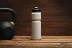 Fitness equipment and supplements on wooden floor in gym Fitness
