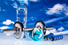 Fitness equipment and water Stock Images