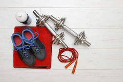 Fitness equipment on white wooden floor Royalty Free Stock Photo