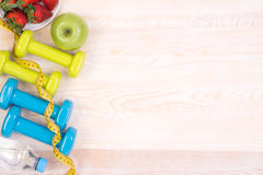 Fitness equipment on wooden background Royalty Free Stock Images