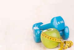 Fitness equipment on wooden background Royalty Free Stock Photos