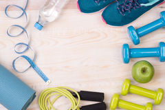 Fitness equipment on wooden background Royalty Free Stock Photo