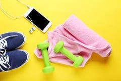 Fitness equipment. On yellow background Stock Photo