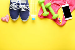 Fitness equipment. On yellow background Royalty Free Stock Images