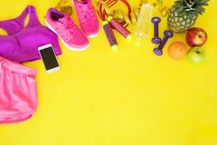 Fitness equipment on yellow background Royalty Free Stock Images