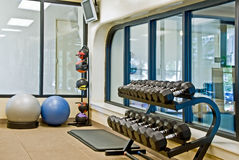 Fitness equipments in a gym stock photography