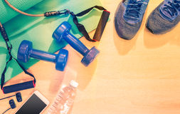 Free Fitness Excercise Equipment On Wood Floor With Warm Light And Le Royalty Free Stock Image - 92392336