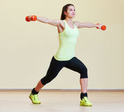 Fitness excercises with dumbbells Stock Photos