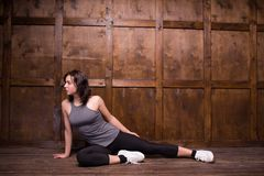 Fitness and exercice concept. Close up image of girl sitting on floor in sport clothes. Sport concept Stock Photo