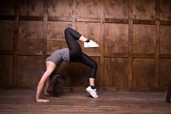 Fitness and exercice concept. Sporty girl doing bridges exercises. Sport concept Stock Images