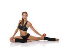 Fitness exercise and an apple Royalty Free Stock Photo