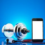 Fitness exercise equipment dumbbell weights on blue background. Stock Photography