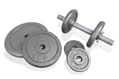 Fitness exercise equipment silver dumbbell and weights plate iso Stock Images