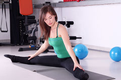 Fitness exercise girl stretching Royalty Free Stock Photos