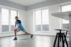 Fitness Exercise. Man Stretching Warming Up Body Before Training. Man Fitness Exercise. Handsome Athletic Male Stretching Body Before Training. Healthy Muscular Royalty Free Stock Photography