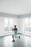 Fitness Exercise. Man Stretching Warming Up Body Before Training. Man Fitness Exercise. Handsome Athletic Male Stretching Body Before Training. Healthy Muscular Royalty Free Stock Images