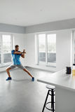 Fitness Exercise. Man Stretching Warming Up Body Before Training. Man Fitness Exercise. Handsome Athletic Male Stretching Body Before Training. Healthy Muscular Royalty Free Stock Photo