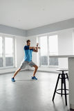 Fitness Exercise. Man Stretching Warming Up Body Before Training Royalty Free Stock Image