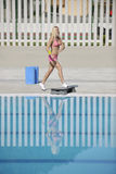 Fitness exercise at poolside Royalty Free Stock Photography