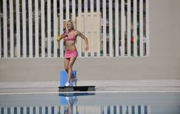 Fitness exercise at poolside Stock Image