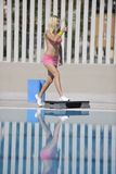 Fitness exercise at poolside Royalty Free Stock Images