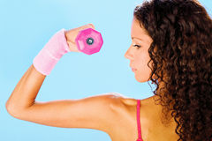 Fitness exercise with weight, side view. Young pretty woman doing fitness exercise with weight, side view Royalty Free Stock Images