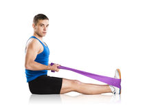 Fitness exercises. Young athlete doing exercises with a resistance band Stock Images