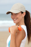 Fitness exercises on the beach Stock Image