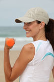 Fitness exercises on the beach Stock Photography