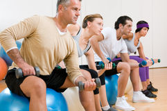 Fitness exercises at gym Stock Photography