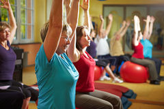 Fitness exercises in gym Stock Image